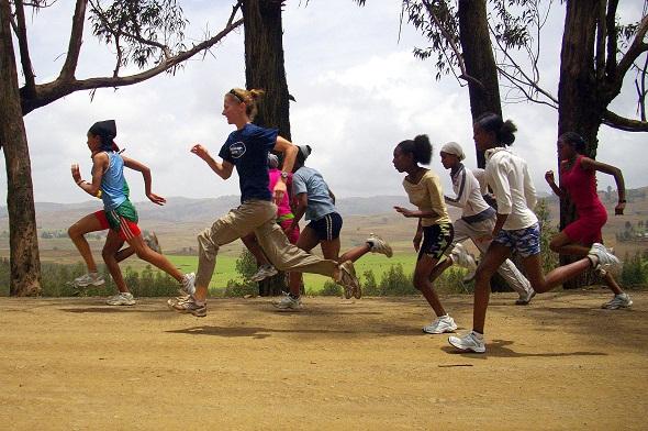 Gaby Grebski (Y '93) runs with Simien girl runners in Ethiopia (image courtesy of Gaby Grebski)