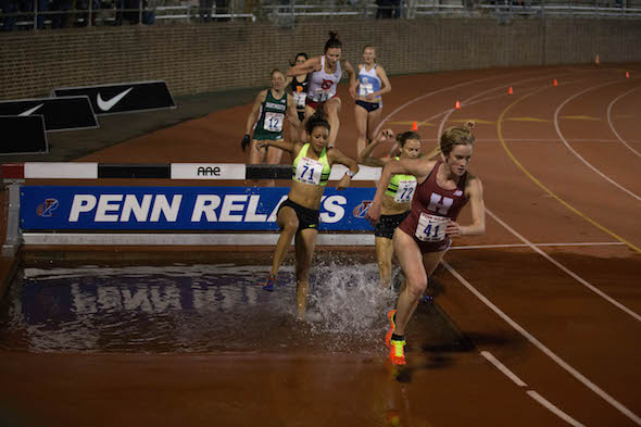 Harvard's Paige Kouba leads going out of the water pit in the CW Steeplechase Championships.  Kouba wins the collegiate championships in 10:26.93