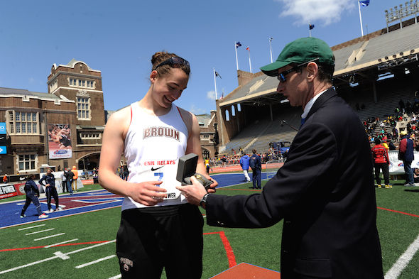 Brown's Josie Natrasevschi receives the watch she won for the CW Discus Throw Championship